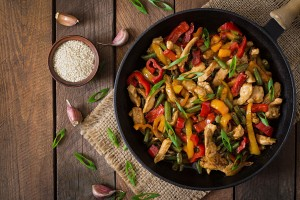 46016041 - stir fry chicken, sweet peppers and green beans. top view
